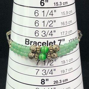 Vintage Jewelry - Vintage Liquid silver cats eye jade style bracelet